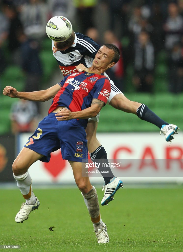 Leigh Broxham of the Victory is challenged by Ryan Griffiths of the Jets during the round 22 ALeague match between the Melbourne Victory and the...