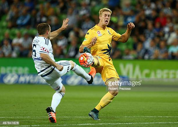 Leigh Broxham of Victory and Josh Bingham of Central Coast contest the ball during the round seven ALeague match between Melbourne Victory and...