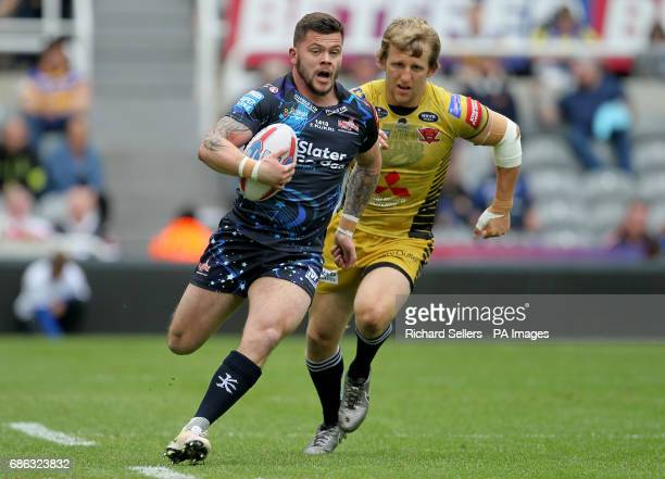Leigh Centurians' Liam Hood gets away from Salford reds Kris Welham during day two of the Betfred Super League Magic Weekend at St James' Park...