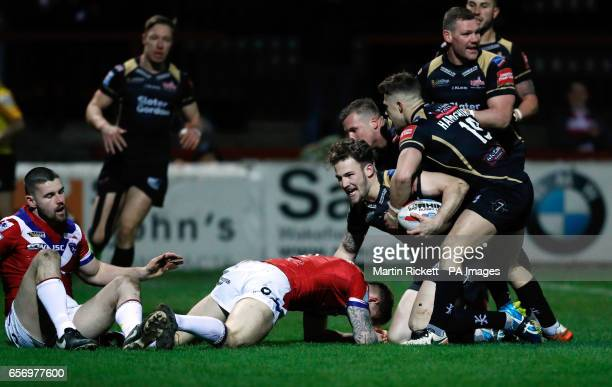 Leigh Centurions' Ben Reynolds celebrates scoring his side's first try with teammates during the Betfred Super League match at Belle Vue Wakefield
