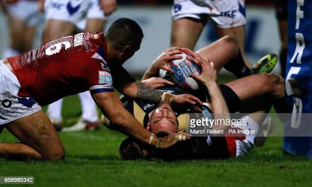 Leigh Centurions' Sam Hopkins goes over for a try during the Betfred Super League match at Belle Vue Wakefield