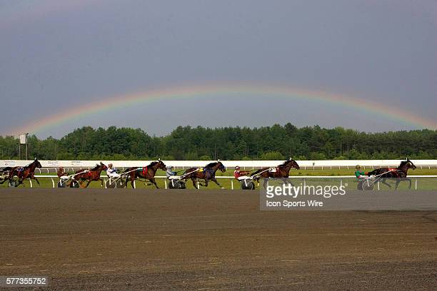 Leigh Fitch driving RUN HOLLY RUN leads the race going into the stretch and under the rainbow Friday at Scarbrough Downs in Scarborough Maine despite...