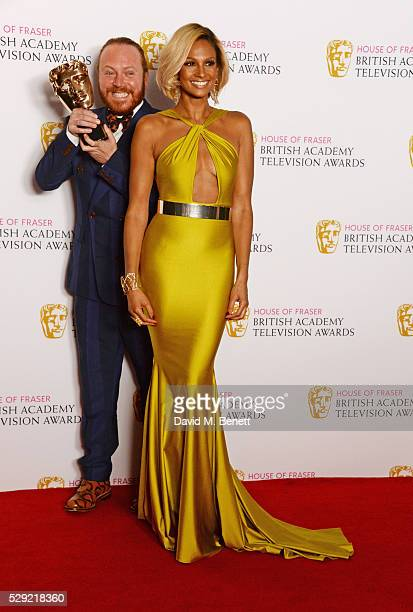 Leigh Francis aka Keith Lemon winner of the Entertainment Performance award for 'Celebrity Juice' and Alesha Dixon pose in the winners room at the...