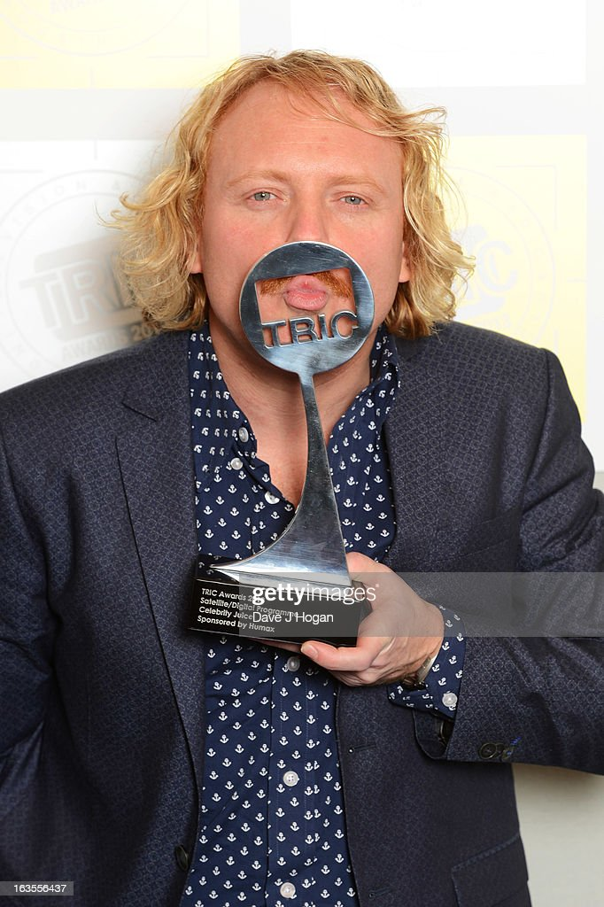 <a gi-track='captionPersonalityLinkClicked' href=/galleries/search?phrase=Leigh+Francis&family=editorial&specificpeople=211146 ng-click='$event.stopPropagation()'>Leigh Francis</a> poses with his Digital Programme Award in front of the winners boards at the TRIC Awards 2013 at The Grosvenor House Hotel on March 12, 2013 in London, England.