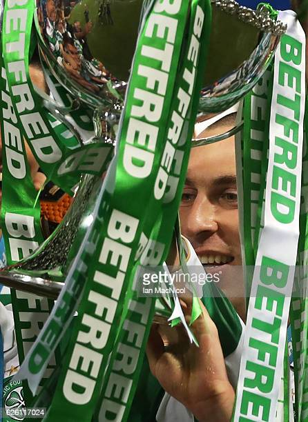 Leigh Griffiths and Scott Brown of Celtic lift the trophy during the Betfred Cup Final between Aberdeen and Celtic at Hampden Park on November 27...