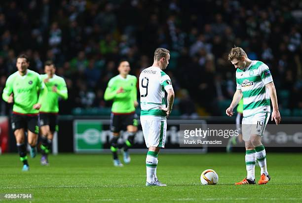 Leigh Griffiths and Stuart Armstrong of Celtic look dejected as Arkadiusz Milik of Ajax scores an equalising goal during the UEFA Europa League Group...