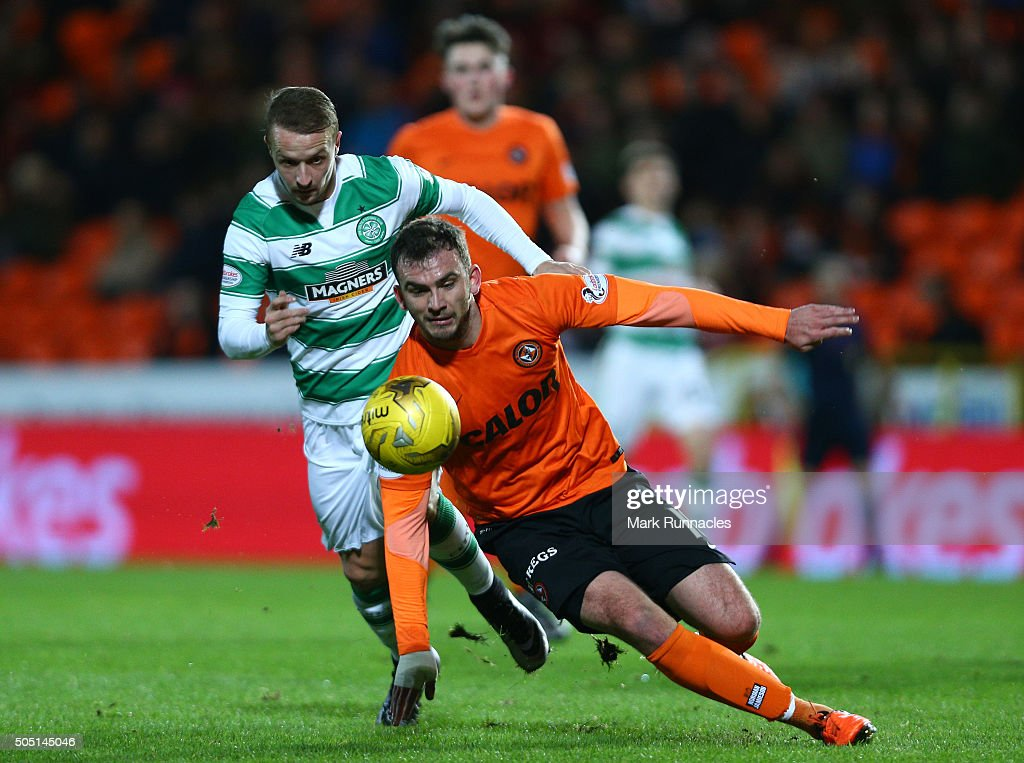 Leigh Griffiths of Celtic and Gavin Gunning of Dundee United challenge during the Ladbrokes Scottish Premiership match between Celtic FC and Dundee United FC at Tannadice Park on January 15, 2016 in Dundee, Scotland.