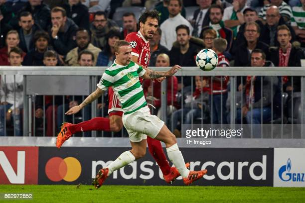 Leigh Griffiths of Celtic and Mats Hummels of Bayern Muenchen battle for the ball during the UEFA Champions League group B match between Bayern...