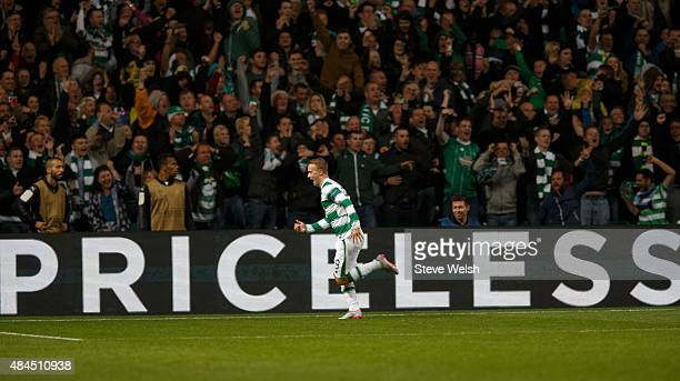 Leigh Griffiths of Celtic celebrates scoring his second goal during the UEFA Champions League Qualifying Round playoff first leg match between Celtic...