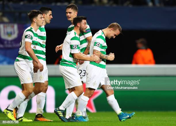 Leigh Griffiths of Celtic celebrates scoring his sides first goal with team mates during the UEFA Champions League group B match between RSC...