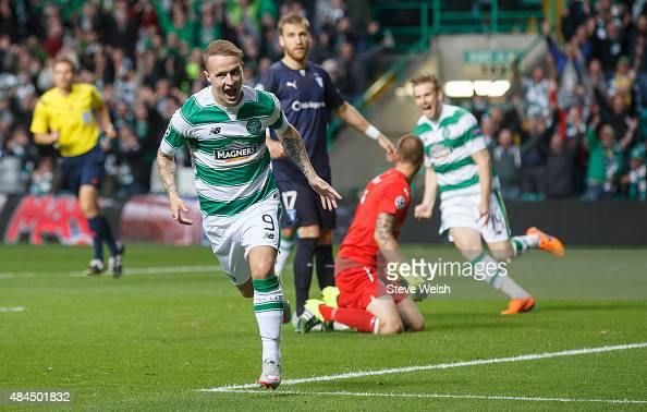 Leigh Griffiths of Celtic celebrates scoring his team's first goal during the UEFA Champions League Qualifying Round Play off First Leg match between...