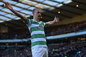 Leigh Griffiths of Celtic celebrates scoring the opening goal during the Scottish League Cup SemiFinal between Celtic and Rangers at Hampden Park on...