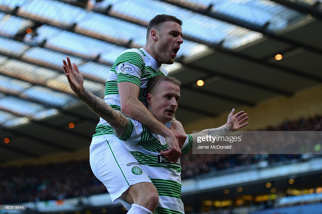 Leigh Griffiths of Celtic (bottom) celebrates scoring the opening goal with Anthony Stokes of Celtic during the Scottish League Cup Semi-Final between Celtic and Rangers at Hampden Park on February 1, 2015 in Glasgow, Scotland.
