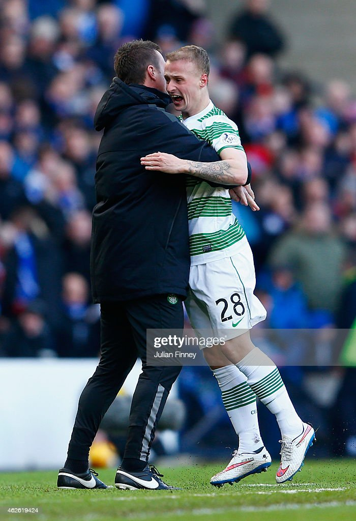 Leigh Griffiths of Celtic celebrates scoring the opening goal with Manager Ronny Deila of Celtic during the Scottish League Cup Semi-Final between Celtic and Rangers at Hampden Park on February 1, 2015 in Glasgow, Scotland.