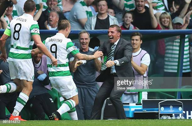 Leigh Griffiths of Celtic celebrates scoring the second goal with Brendan Rodgers manager of Celtic during the UEFA Champions League Playoff First...