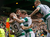 Leigh Griffiths of Celtic celebrates with teammates after scoring his team's first goal during the UEFA Champions League Qualifying Round Play off...