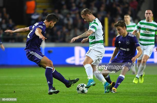 Leigh Griffiths of Celtic FC is tackled by RSC Anderlecht's Pieter Gerkens and Leander Dendoncker during the UEFA Champions League Group B football...