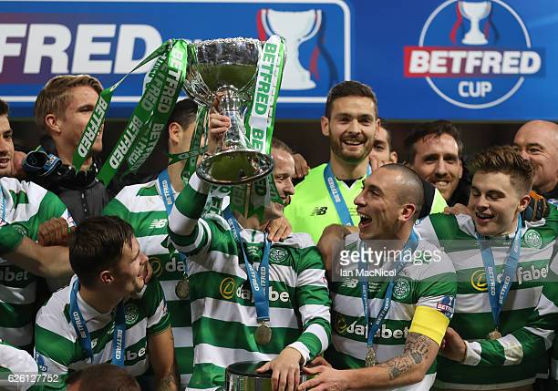 Leigh Griffiths of Celtic lifts the trophy during the Betfred Cup Final between Aberdeen and Celtic at Hampden Park on November 27 2016 in Glasgow...