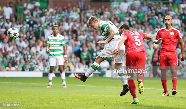 Leigh Griffiths of Celtic scores the second goal with a header during the UEFA Champions League Playoff First leg match between Celtic and Hapoel...
