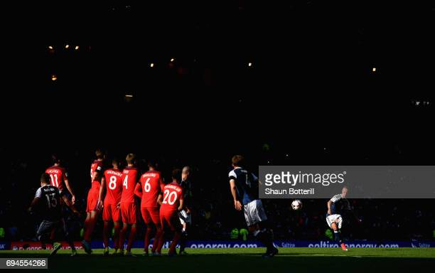 Leigh Griffiths of Scotland scores his sides second goal from a freekick during the FIFA 2018 World Cup Qualifier between Scotland and England at...