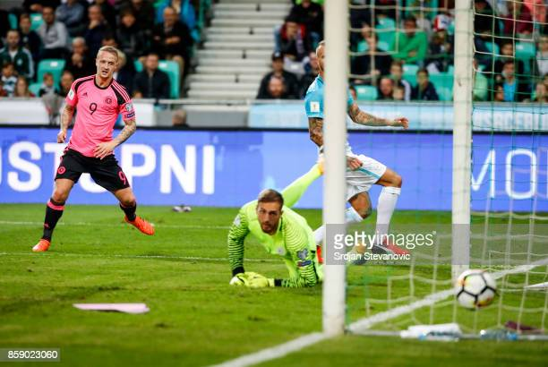Leigh Griffiths of Scotland scores the opening goal near goalkeeper Jan Oblak of Slovenia during the FIFA 2018 World Cup Qualifier match between...