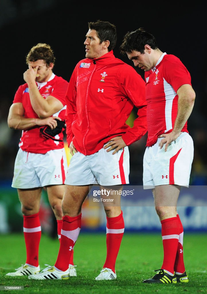 Leigh Halfpenny, James Hook and Stephen Jones of Wales show their dejection after the 2011 IRB Rugby World Cup bronze final match between Wales and Australia at Eden Park on October 21, 2011 in Auckland, New Zealand.