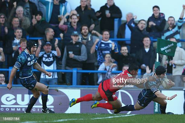 Leigh Halfpenny of Cardiff Blues scores the opening try as David Smith of Toulon fails to tackle during the Heineken Cup Pool Six match between...