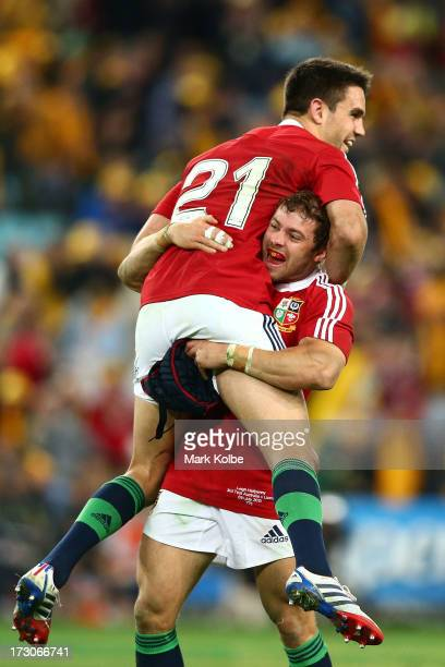 Leigh Halfpenny of the Lions and team mate Connor Murray celebrate winning the International Test match between the Australian Wallabies and British...