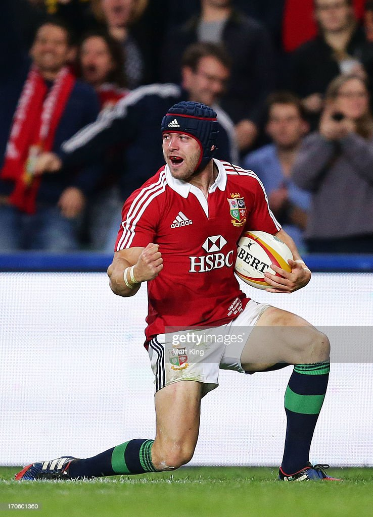 Leigh Halfpenny of the Lions celebrates after scoring a try during the match between the NSW Waratahs and the British & Irish Lions at Allianz Stadium on June 15, 2013 in Sydney, Australia.