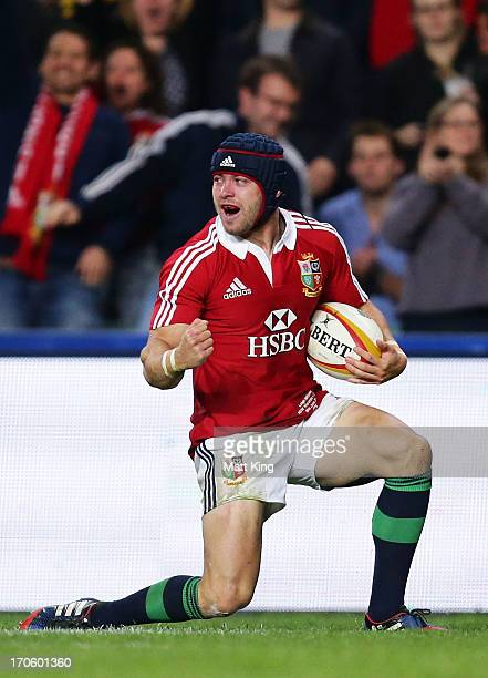 Leigh Halfpenny of the Lions celebrates after scoring a try during the match between the NSW Waratahs and the British Irish Lions at Allianz Stadium...