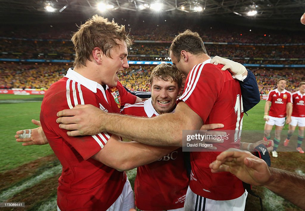 Leigh Halfpenny of the Lions celebrates with team mates Jonathan Davies and Jamie Roberts after their victory during the International Test match...