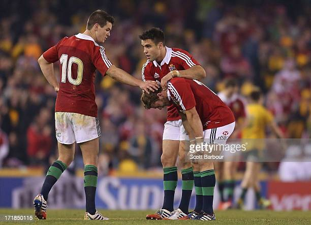 Leigh Halfpenny of the Lions is consoled by his teammates after missing a penalty kick in the final minute of the match during game two of the...