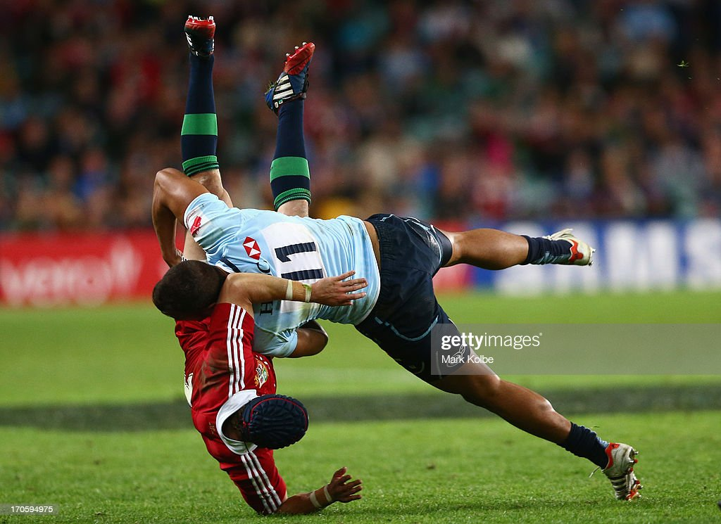 Leigh Halfpenny of the Lions is tackled by Peter Betham of the Waratahs during the match between the NSW Waratahs and the British & Irish Lions at Allianz Stadium on June 15, 2013 in Sydney, Australia.