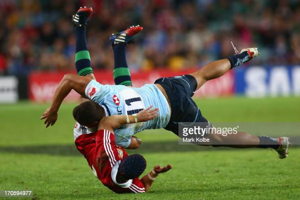 Leigh Halfpenny of the Lions is tackled by Peter Betham of the Waratahs during the match between the NSW Waratahs and the British Irish Lions at...