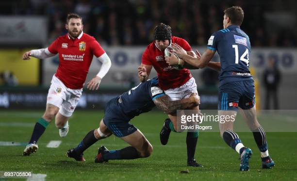 Leigh Halfpenny of the Lions is tackled by SonnyBill Williams during the match between the Auckland Blues and the British Irish Lions at Eden Park on...