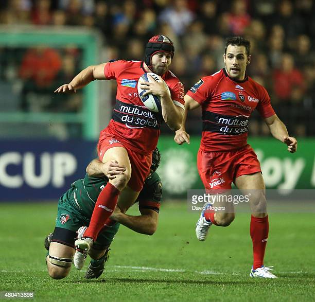 Leigh Halfpenny of Toulon is tackled by Julian Salvi during the European Rugby Champions Cup pool three match between RC Toulon and Leicester Tigers...