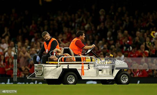 Leigh Halfpenny of Wales is stretchered off the field after suffering a leg injury during the International Match between Wales and Italy at...