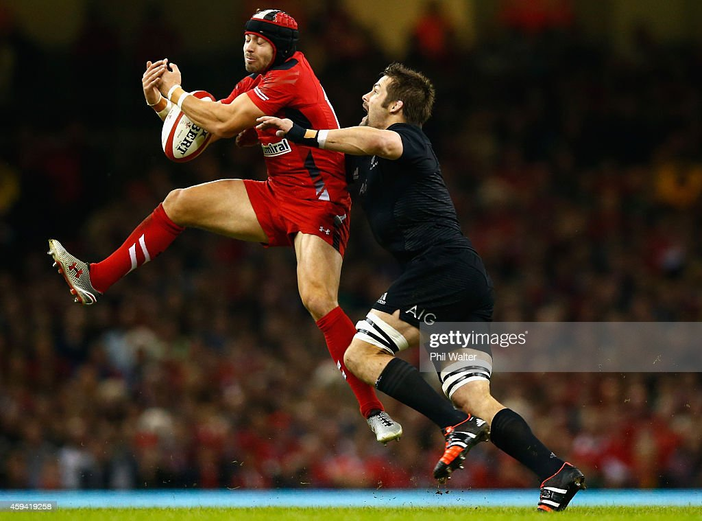 <a gi-track='captionPersonalityLinkClicked' href=/galleries/search?phrase=Leigh+Halfpenny&family=editorial&specificpeople=4232760 ng-click='$event.stopPropagation()'>Leigh Halfpenny</a> of Wales is tackled by <a gi-track='captionPersonalityLinkClicked' href=/galleries/search?phrase=Richie+McCaw&family=editorial&specificpeople=165235 ng-click='$event.stopPropagation()'>Richie McCaw</a> during the Intenational match between Wales and the New Zealand All Blacks at the Millennium Stadium on November 22, 2014 in Cardiff, Wales.