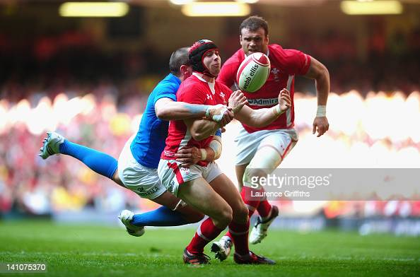 Leigh Halfpenny of Wales is tackled by Sergio Parisse of Italy during the RBS Six Nations match between Wales and Italy at Millenium Stadium on March...