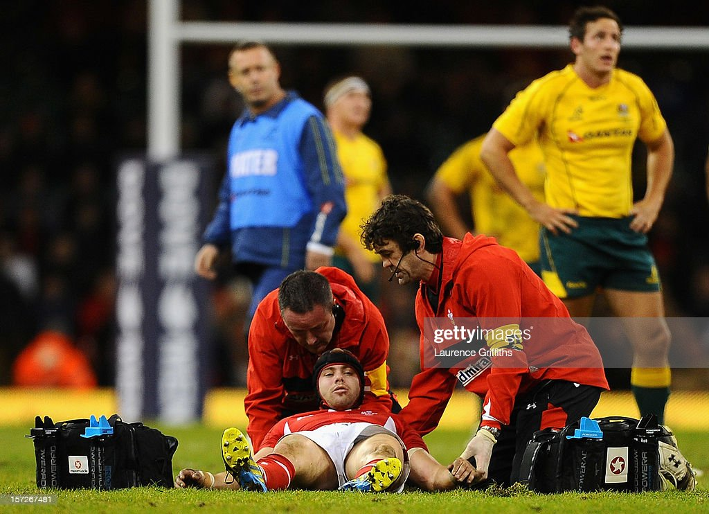 <a gi-track='captionPersonalityLinkClicked' href=/galleries/search?phrase=Leigh+Halfpenny&family=editorial&specificpeople=4232760 ng-click='$event.stopPropagation()'>Leigh Halfpenny</a> of Wales receives treatment during the International match between Wales and Australia at Millennium Stadium on December 1, 2012 in Cardiff, Wales.
