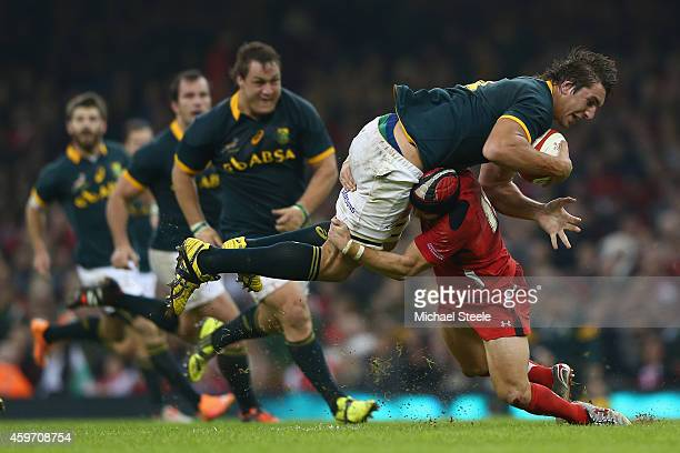 Leigh Halfpenny of Wales tackles Eben Etzebeth of South Africa during the International match betwwen Wales and South Africa at the Millennium...