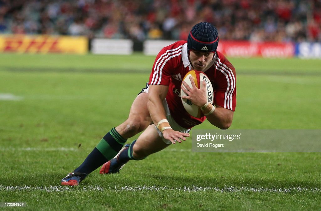 <a gi-track='captionPersonalityLinkClicked' href=/galleries/search?phrase=Leigh+Halfpenny&family=editorial&specificpeople=4232760 ng-click='$event.stopPropagation()'>Leigh Halfpenny</a>, the Lions fullback, dives over for the Lions second try during the match between the NSW Waratahs and the British & Irish Lions at Allianz Stadium on June 15, 2013 in Sydney, Australia.