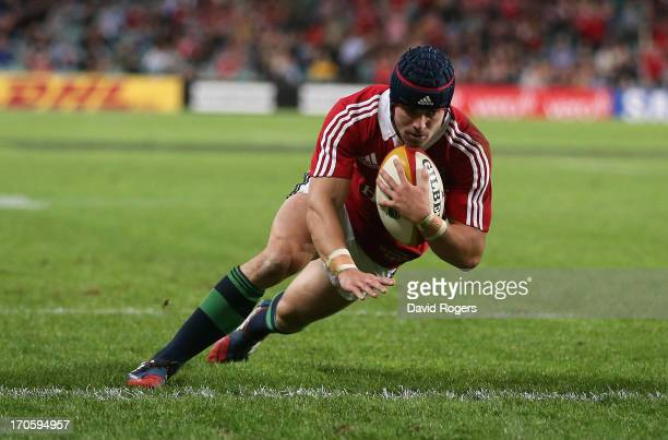 Leigh Halfpenny the Lions fullback dives over for the Lions second try during the match between the NSW Waratahs and the British Irish Lions at...