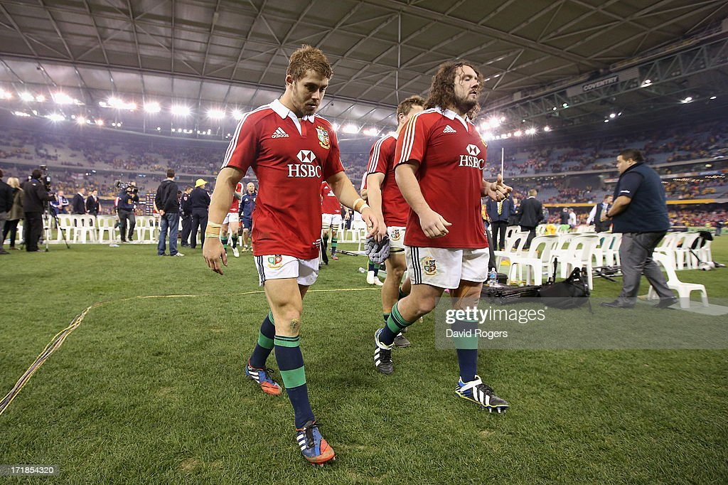 Leigh Halfpenny, (L) the Lions fullback, who had a chance to win the match with a last minute penalty walks off the field with team mate Adam Jones after their defeat during game two of the International Test Series between the Australian Wallabies and the British & Irish Lions at Etihad Stadium on June 29, 2013 in Melbourne, Australia.