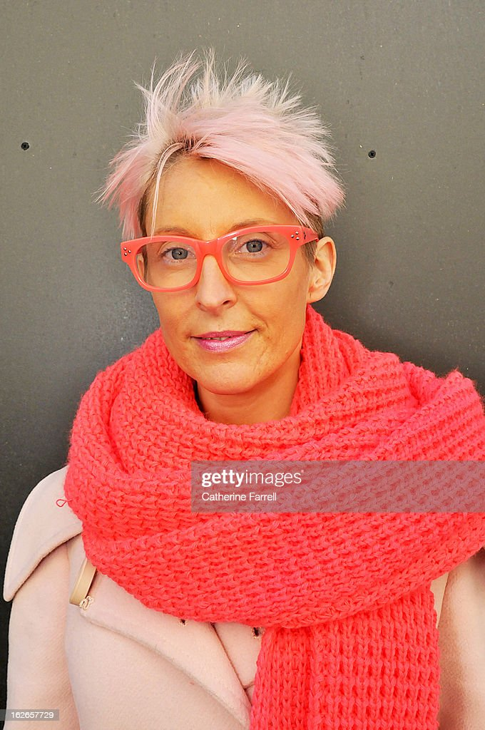 Leigh Hawkes Fashion Forecaster for Sports Girl, Melbourne wearing a vintage coat with Sports girl pink flourescent scarf, One Teaspoon pale salmon pink trousers, accessorised with Matthew Williamson sunglasses at London Fashion Week Fall/Winter 2013/14 on February 19, 2013 in London, England.