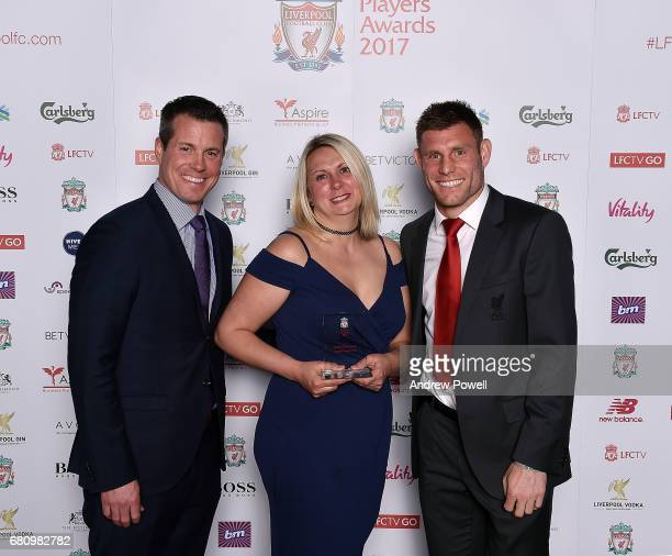 Leigh Hawksworth employee of Liverpool with James Milner player of Liverpool and Billy Hogan managing director and chief commercial officer after...