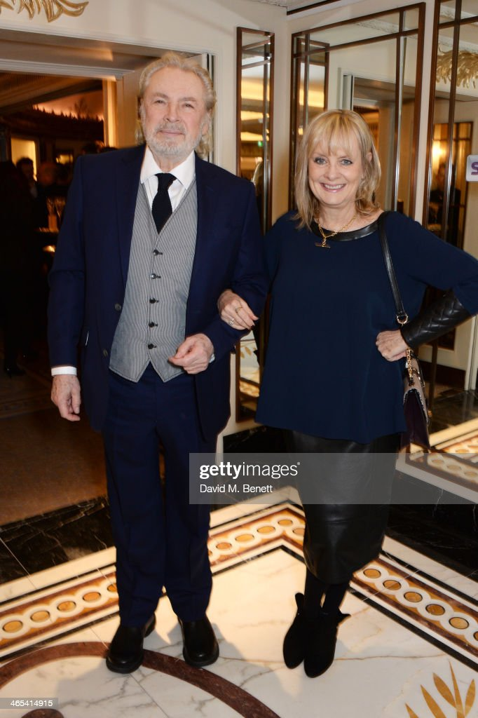 Leigh Lawson (L) and Twiggy attend a drinks reception at the South Bank Sky Arts awards at the Dorchester Hotel on January 27, 2014 in London, England.