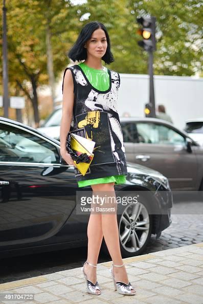 Leigh Lezark poses wearing Miu Miu before the Miu Miu show at the Palais de Iena during Paris Fashion Week SS16 on October 7 2015 in Paris France