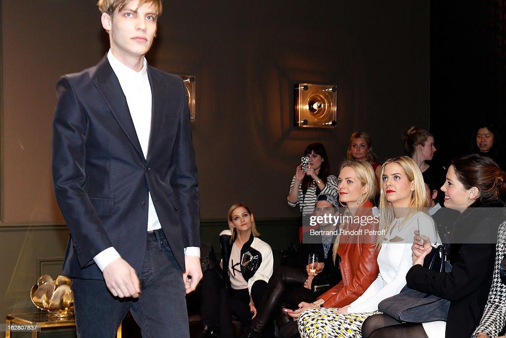 Leigh Lezark Virginie CourtinClarins Jenna CourtinClarins and Prisca CourtinClarins look on as a model walks the runway during the HM Fashion Show...