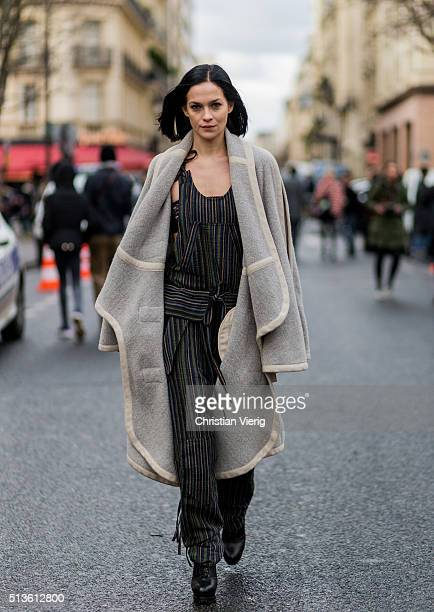 Leigh Lezark wearing a jumpsuit and a grey wool coat outside Chloe during the Paris Fashion Week Womenswear Fall/Winter 2016/2017 on March 3 2016 in...